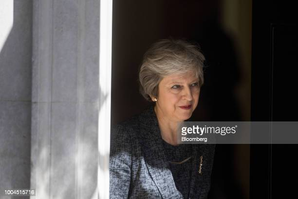 Theresa May UK prime minister leaves number 10 Downing Street to greet Qatars Emir Sheikh Tamim bin Hamad Al Thani in London UK on Tuesday July 24...