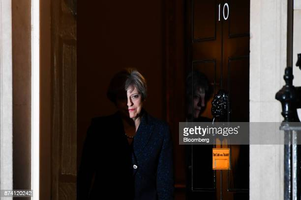 Theresa May UK prime minister leaves number 10 Downing Street to greet Scotland's First Minister Nicola Sturgeon in London UK on Tuesday Nov 14 2017...