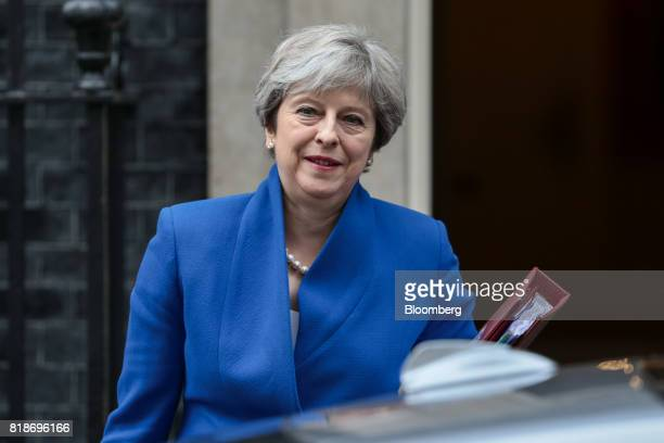 Theresa May UK prime minister leaves number 10 Downing Street to attend the weekly questions and answers session in parliament in London UK on...