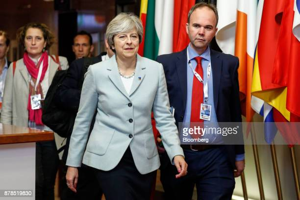 Theresa May UK prime minister leaves the Eastern Partnership Summit at the Europa building in Brussels Belgium on Friday Nov 24 2017 May meets...