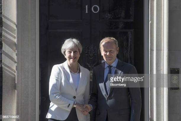 Donald Tusk president of the European Union gestures while departing from a meeting with Theresa May UK prime minister not pictured at number 10...