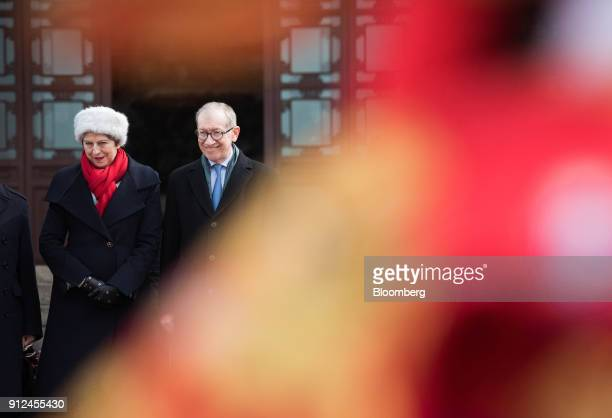 Theresa May UK prime minister left and her husband Philip May watch a performance of Chinese opera at the Yellow Crane Tower in Wuhan China on...