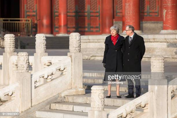 Theresa May UK prime minister left and Philip May her husband tour the Forbidden City in Beijing China on Thursday Feb 1 2018 May is leading the...
