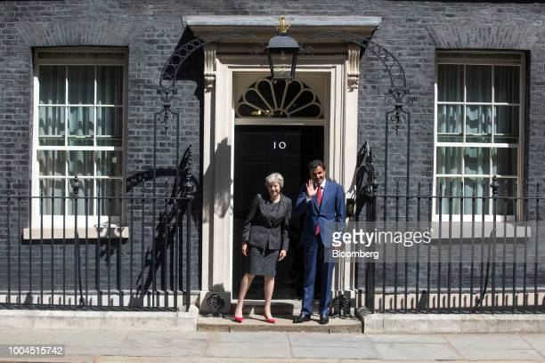Theresa May UK prime minister left and Qatars Emir Sheikh Tamim bin Hamad Al Thani pose for photographers outside number 10 Downing Street in London...