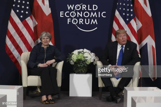 Theresa May UK prime minister left and US President Donald Trump pose for photographs during a bilateral meeting on day three of the World Economic...