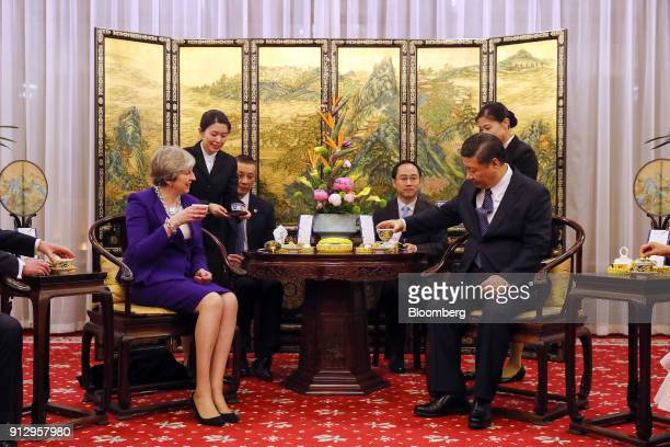 Theresa May UK prime minister left and Xi Jinping China's president right take part in a tea ceremony at the Diaoyutai State Guest House in Beijing...