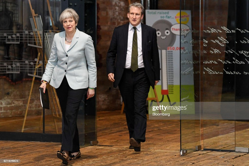Theresa May, U.K. prime minister, left, arrives with David Hinds, U.K. education secretary, to deliver a speech on education at Derby College in Derby, U.K., on Monday, Feb. 19, 2018. May set out to repair her image with young voters with a warning over the cost and quality of university courses, and an acknowledgment that students were being failed by a funding system that leaves them with crippling debts. Photographer: Facundo Arrizabalaga/Pool via Bloomberg