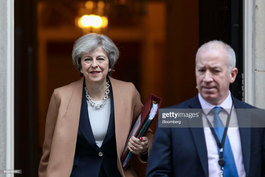 Theresa May, U.K. prime minister, left, carries a document folder as she leaves 10 Downing Street to attend the weekly question-and-answer session in the House of Commons, in London, U.K., on Wednesday, March 15, 2017. The European Union is considering forcing the U.K. to wait until June for formal negotiations to begin on the terms of Brexit, eroding the time May has to land a deal, according to EU officials. Photographer: Simon Dawson/Bloomberg via Getty Images