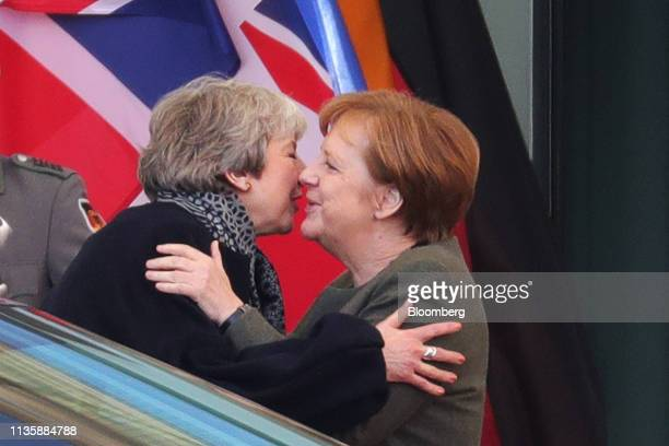 Theresa May UK prime minister left embraces Angela Merkel Germany's chancellor as she leaves following talks at the Chancellery in Berlin Germany on...