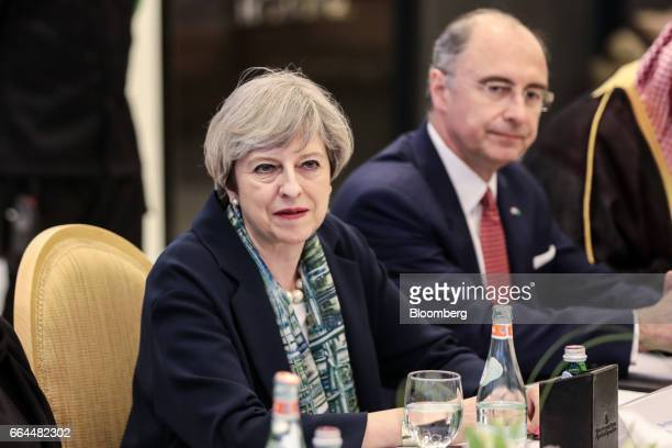 Theresa May UK prime minister left looks on as she attends a meeting with Xavier Rolet chief executive officer of London Stock Exchange Group Plc...