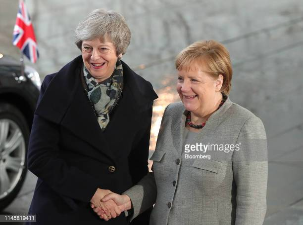 Theresa May UK prime minister left shakes hands with Angela Merkel Germany's chancellor ahead of talks at the Chancellery in Berlin Germany on...