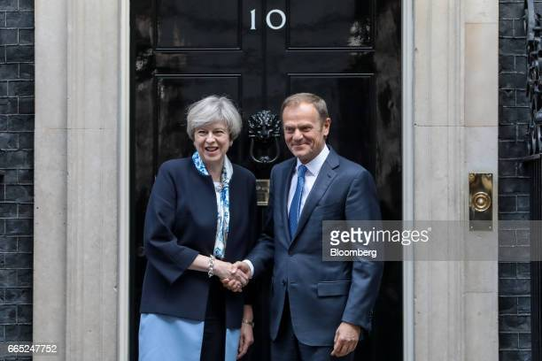 Theresa May UK prime minister left shakes hands with Donald Tusk president of the European Union outside number 10 Downing Street in London on...