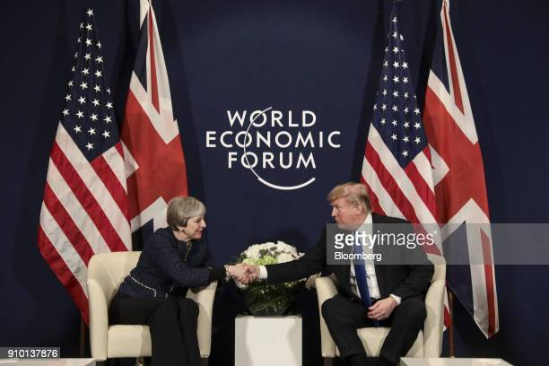 Theresa May UK prime minister left shakes hands with US President Donald Trump during a bilateral meeting on day three of the World Economic Forum in...