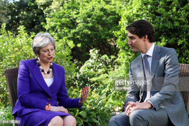 Theresa May UK prime minister left speaks to Justin Trudeau Canada's prime minister during a bilateral meeting in the gardens of number 10 Downing...