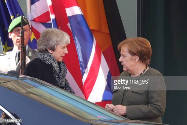 Theresa May UK prime minister left speaks with Angela Merkel Germany's chancellor as she leaves following talks at the Chancellery in Berlin Germany...