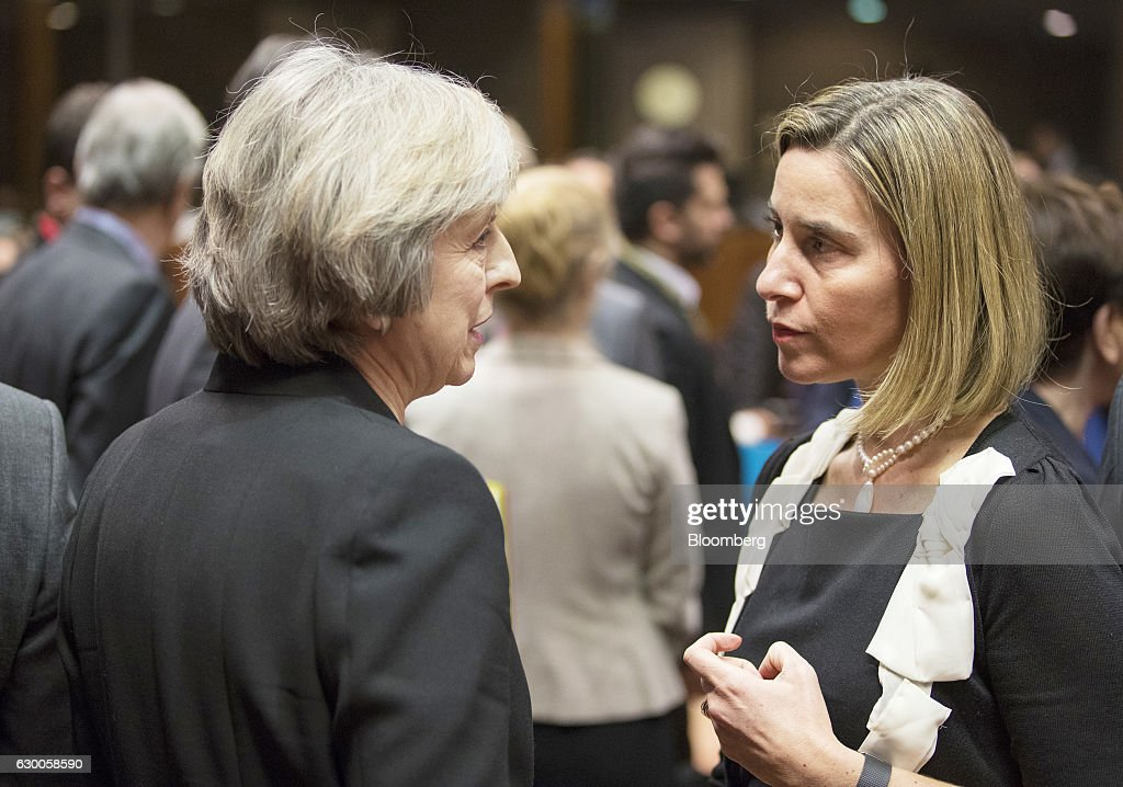 Theresa May, U.K. prime minister, left, speaks with Federica Mogherini, foreign affairs representative and vice-president of the European Commission, as they arrive for a meeting of European Union (EU) leaders in Brussels, Belgium, on Thursday, Dec. 15, 2016. A first glimpse of the European Union's potential for disunity on Brexit emerged at the Brussels summit, as EU leaders were caught up in a dispute over how the bloc negotiates with the U.K. as it heads for the door. Photographer: Jasper Juinen/Bloomberg via Getty Images