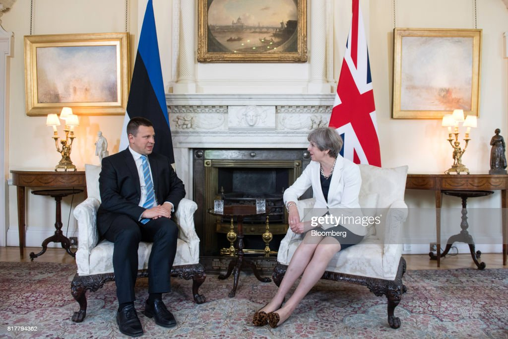 Theresa May, U.K. prime minister, left, speaks with Juri Rata, Estonia's prime minister, during their bilateral meeting inside number 10 Downing Street in London, U.K., on Tuesday, July 18, 2017. May is being encouraged to fire disloyal ministers who risk tearing the government apart and handing power to Labour's Jeremy Corbyn. Photographer: Will Oliver/Pool via Bloomberg