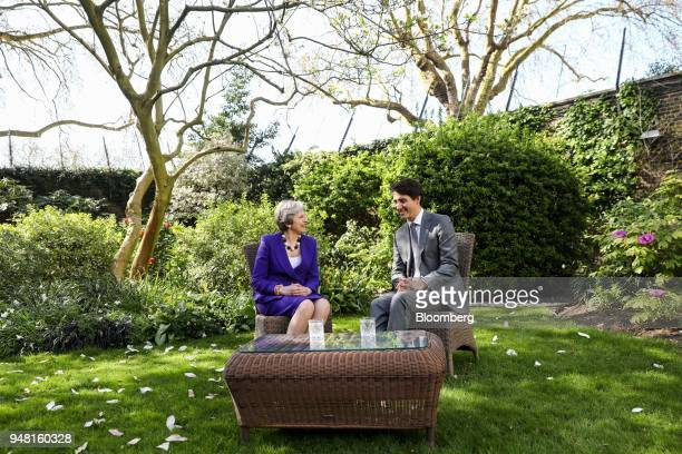 Theresa May UK prime minister left speaks with Justin Trudeau Canada's prime minister during a bilateral meeting in the gardens of number 10 Downing...