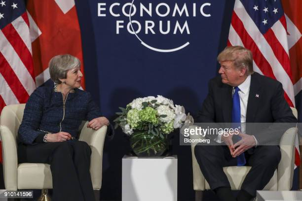 Theresa May UK prime minister left speaks with US President Donald Trump during a bilateral meeting on day three of the World Economic Forum in Davos...