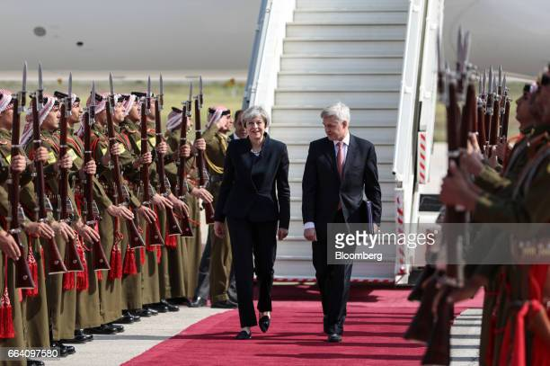 Theresa May UK prime minister left walks with Edward Oakden UK's ambassador to Jordan on her arrival in Amman Jordan on Monday April 3 2017 May began...