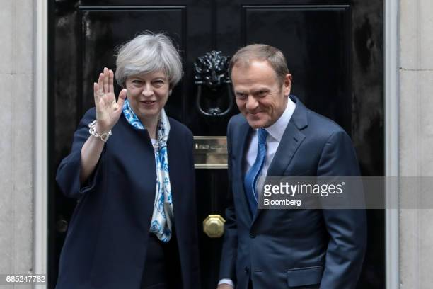 Theresa May UK prime minister left waves as she stands with Donald Tusk president of the European Union outside number 10 Downing Street in London on...