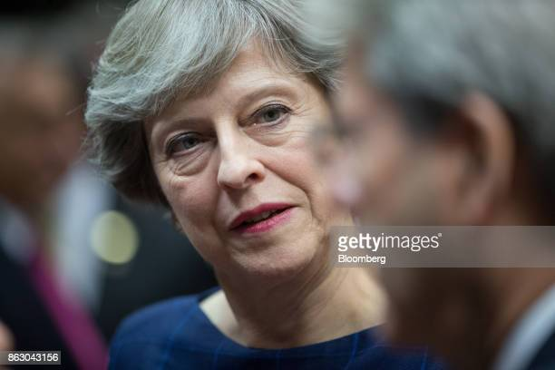 Theresa May UK prime minister looks on ahead of roundtable talks with European Union leaders in Brussels Belgium on Thursday Oct 19 2017 May will...