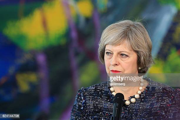 Theresa May UK prime minister looks on during a news conference with Germany's Chancellor Angela Merkel at the Chancellery in Berlin Germany on...