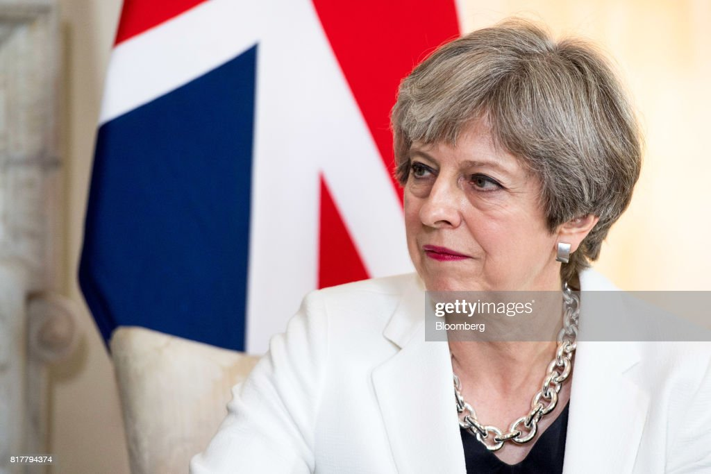 Theresa May, U.K. prime minister, pauses during her bilateral meeting with Estonia's Prime Minister Juri Rata (not pictured) inside number 10 Downing Street in London, U.K., on Tuesday, July 18, 2017. May is being encouraged to fire disloyal ministers who risk tearing the government apart and handing power to Labour's Jeremy Corbyn. Photographer: Will Oliver/Pool via Bloomberg
