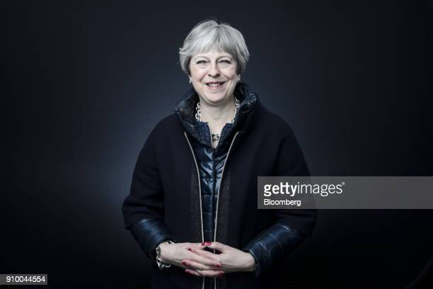 Theresa May UK prime minister poses for a photograph following a Bloomberg Television interview on day three of the World Economic Forum in Davos...