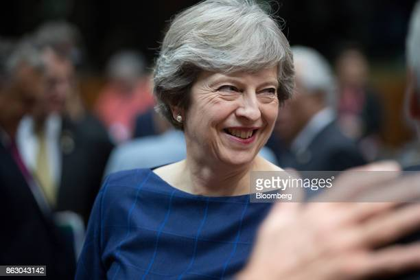 Theresa May UK prime minister reacts ahead of roundtable talks with European Union leaders in Brussels Belgium on Thursday Oct 19 2017 May will...