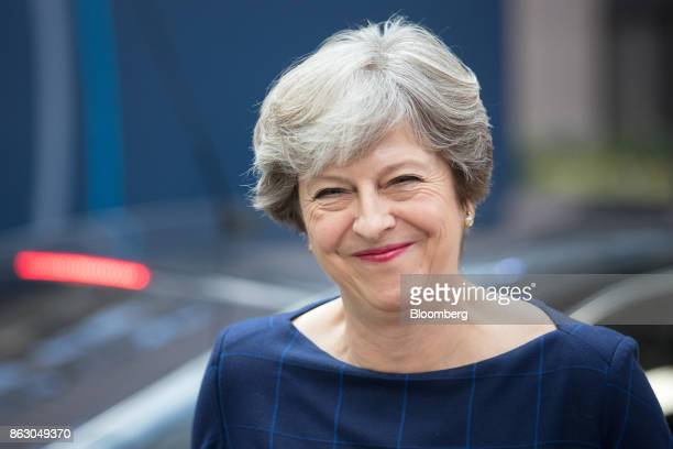 Theresa May UK prime minister reacts as she arrives for a meeting of European Union leaders in Brussels Belgium on Thursday Oct 19 2017 May will...