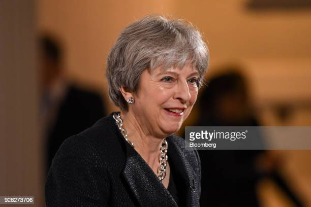 Theresa May UK prime minister reacts as she delivers a speech on Brexit at Mansion House in London UK on Friday March 2 2018 The UK prime minister is...