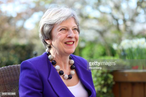 Theresa May UK prime minister reacts during a bilateral meeting with Jacinda Ardern New Zealand's prime minster in the gardens of number 10 Downing...