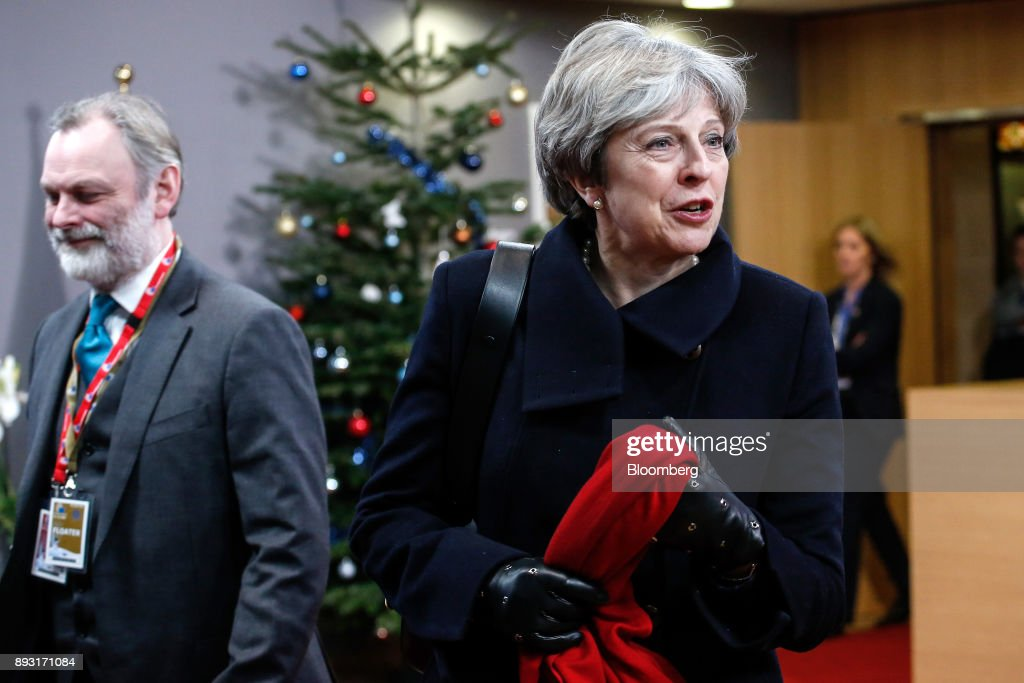 Theresa May, U.K. prime minister, right, and Tim Barrow, U.K. permanent representative to the European Union (EU), leave after attending a European Union (EU) leaders summit at the Europa Building in Brussels, Belgium, early on Friday, Dec. 15, 2017. May asked European leaders to be creative and to persevere to reach a deal when Brexit negotiations move on to trade. Photographer: Dario Pignatelli/Bloomberg via Getty Images