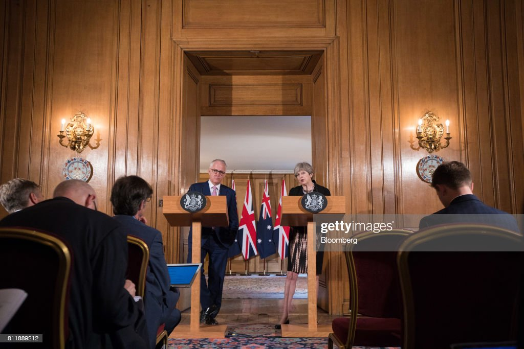 Theresa May, U.K. prime minister, right, speaks during a joint news conference with Malcolm Turnbull, Australia's prime minister, inside number 10 Downing Street in London, U.K., on Monday, July 10, 2017. May came under fire from her own party over the weekend as she prepared to publish a draft law this week intended to repeal the U.K.'s membership of the EU, and set a new legal framework for the country after it withdraws from the bloc. Photographer: Jason Alden/Bloomberg via Getty Images