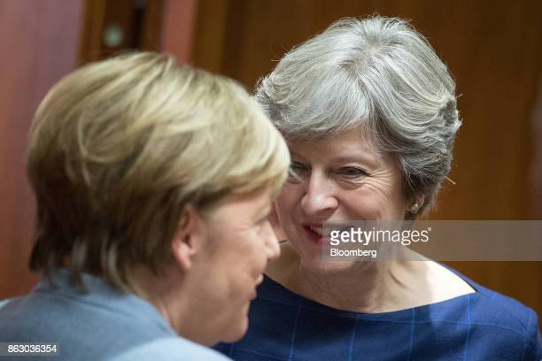 Theresa May UK prime minister right speaks with Angela Merkel Germany's chancellor ahead of roundtable talks with European Union leaders in Brussels...