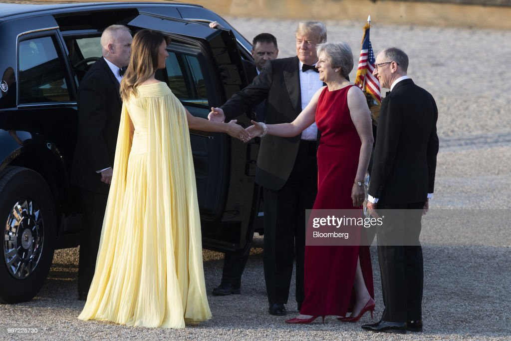 Theresa May, U.K. prime minister, second right, greets U.S. First lady Melania Trump, left, while U.S. President Donald Trump, and Philip May, husband of May, right, stand ahead of a dinner at Blenheim Palace, in Oxfordshire, U.K., on Thursday, July 12, 2018. Trump and the first lady will meet British business leaders at the black-tie dinner attended by more than 100 guests. Photographer: Will Oliver/Pool via Bloomberg