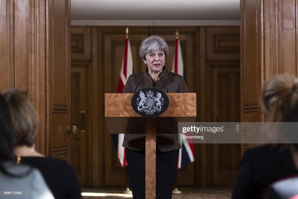 Theresa May, U.K. prime minister, speaks during a news conference at number 10 Downing Street following air strikes in Syria, in London, U.K., on Saturday, April 14, 2018. The U.S., U.K. and France hit targets in Syria in retaliation for an apparent chemical weapons attack outside Damascus by Bashar al-Assads regime. Photographer: Will Oliver/Pool via Bloomberg