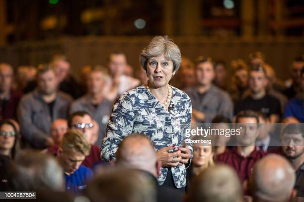 Theresa May UK prime minister gestures as she speaks during a question and answer session with an audience at Reece Group an engineering firm in...