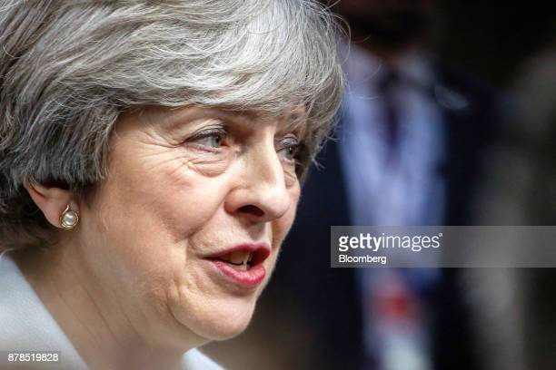 Theresa May UK prime minister speaks to members of the media while leaving the Eastern Partnership Summit at the Europa building in Brussels Belgium...