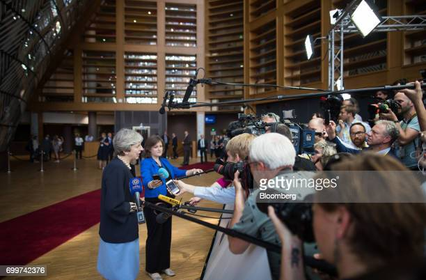 Theresa May UK prime minister speaks to the media as she arrives for a European Union leaders summit at the Europa building in Brussels Belgium on...