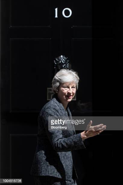 Theresa May UK prime minister stands outside number 10 Downing Street as she greets Qatars Emir Sheikh Tamim bin Hamad Al Thani not pictured in...