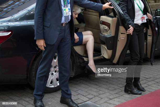 Theresa May UK prime minister steps out of a car as she arrives for a meeting of European Union leaders in Brussels Belgium on Thursday Oct 19 2017...