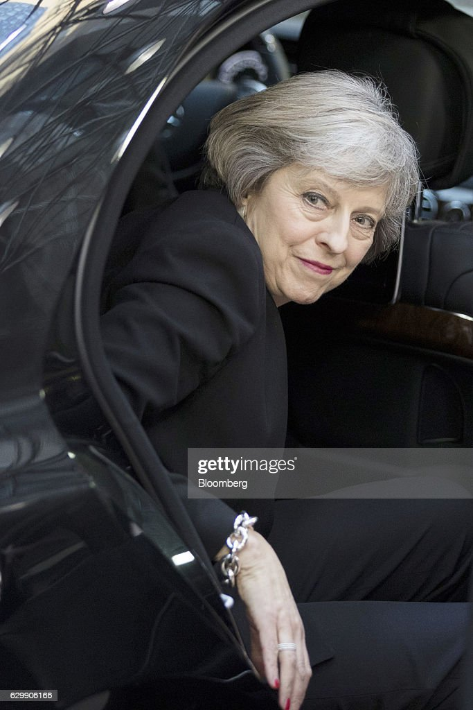Theresa May, U.K. prime minister, steps out of an automobile as she arrives for the European Union (EU) leaders' summit in Brussels, Belgium, on Thursday, Dec. 15, 2016. May wants to trigger the Brexit process by the end of March and the Lords panel said an early goal in the talks should be to agree a transitional period so as to prevent U.K.-based financial-services firms from restructuring or relocating on the basis of a worst-case scenario. Photographer: Jasper Juinen/Bloomberg via Getty Images