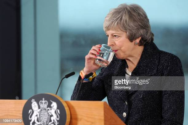 Theresa May UK prime minister takes a drink of water while speaking in Belfast Northern Ireland on Tuesday Feb 5 2019 May started a twoday visit to...