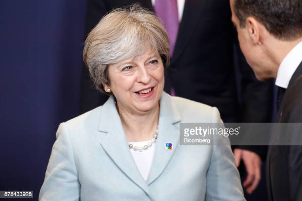 Theresa May UK prime minister talks to a fellow participant during a family photo session at the Eastern Partnership Summit inside the Europa...