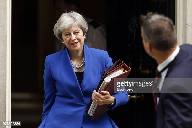 A giant bouquet of flowers is left for Theresa May UK prime minister outside 10 Downing Street from the National Floristy Association to celebrate...