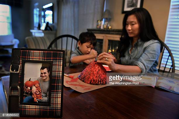 Theresa McLaughlin and son Mikey age 4 They are making a volcano art project Theresa's husband Mike McLaughlin is stationed in Japan and the family...