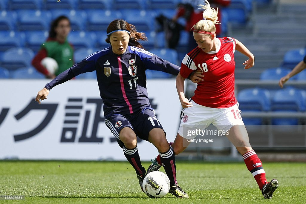 Theresa Nielsen of Denmark challenges Yuki Ogimi of Japan during the Algarve Cup 2013 match between Denmark and Japan at the Algarve stadium on March 11, 2013 in Faro, Portugal.