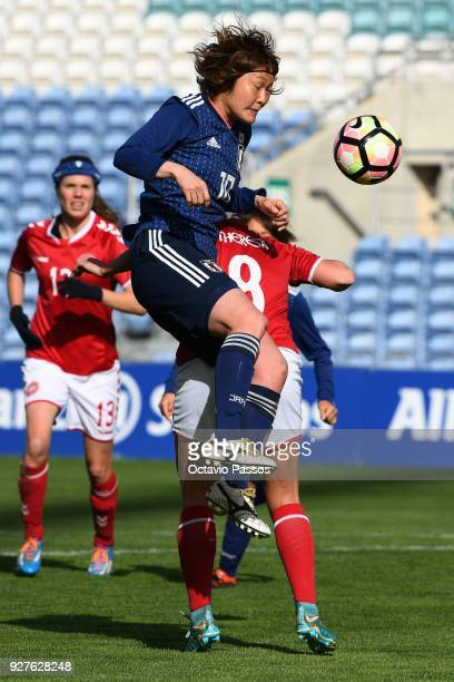 Theresa Nielsen of Denmark competes for the ball with Mizuho Sakaguchi of Japan during the Women's Algarve Cup Tournament match between Denmark and...